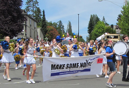 BHS Cheer Team Marching for Make Some Noise NW at the 2014 Grand Old 4th Parade on Bainbridge Island